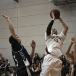 Kwantlen shooting guard Aaron Ram avoids contact from a Capilano Blues defender to put home two of his game-high 34 points, Friday, Feb. 1 in Surrey. (Brian Jones/The Runner_