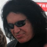 KISS bassist turned international television star Gene Simmons happily signs autographs for fans at the Red Robinson Theatre. Photo by Jacob Zinn.
