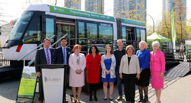 Members of Surrey City Council and KSA President Caitlin McCutchen pose in front of the LRT vehicle showcase. (Submitted)