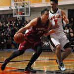 Tristan Gruenthaler.jpg' - 6-fot-6 Kwantlen forward Tristan Gruenthaler drives the lane past Falcons guard Garrett Ling-Lee Friday night at Langara.