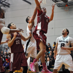 Kwantlen&#039;s Aaron Ram fights past the Royals for the lay-up. (Brian Jones/The Runner)