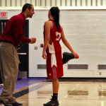 Eagles head coach Dan Nayebzadeh talks to guard Jeanneine Yngreso on the sidelines during the third quarter of their quarterfinal matchup versus Quest on Thursday. (Matt Boss/The Runner)