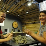 Melinda Bige and Roxanne Charles wrap fresh sage in the Aboriginal Gathering Place on Kwantlen Polytechnic Universities Surrey Campus on Friday afternoon. (Matt Law / The Runner)