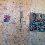 Messages written on the plywood wall of downtown Vancouver's Bay department store. /Kimiya Sokoohi