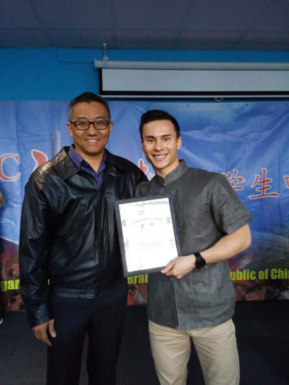 "Alex Tam (right) won third place in the ""Chinese Bridge"" competition. (kpu.ca)"