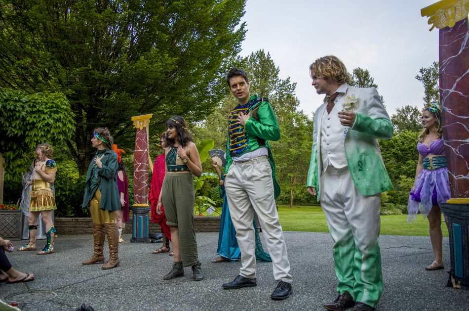 Five actors, all portraying fairy delinquent Puck, deliver the final soliloquy of the performance. (Photo: Braden Klassen. Costume design: Shayan Naziripour)