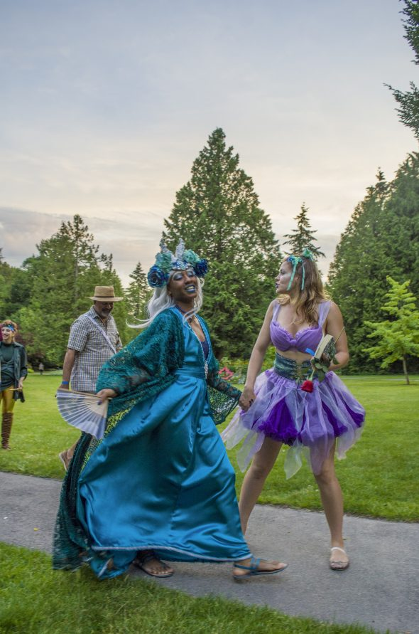 Actors portraying fairy Queen Titania and her companion stride through Bear Creek Park during a performance of Slumber Here. (Photo: Braden Klassen. Costume design: Shayan Naziripour)